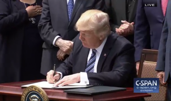Trump signing a document
